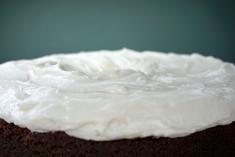 Cream cheese frosting atop Guinness chocolate cake